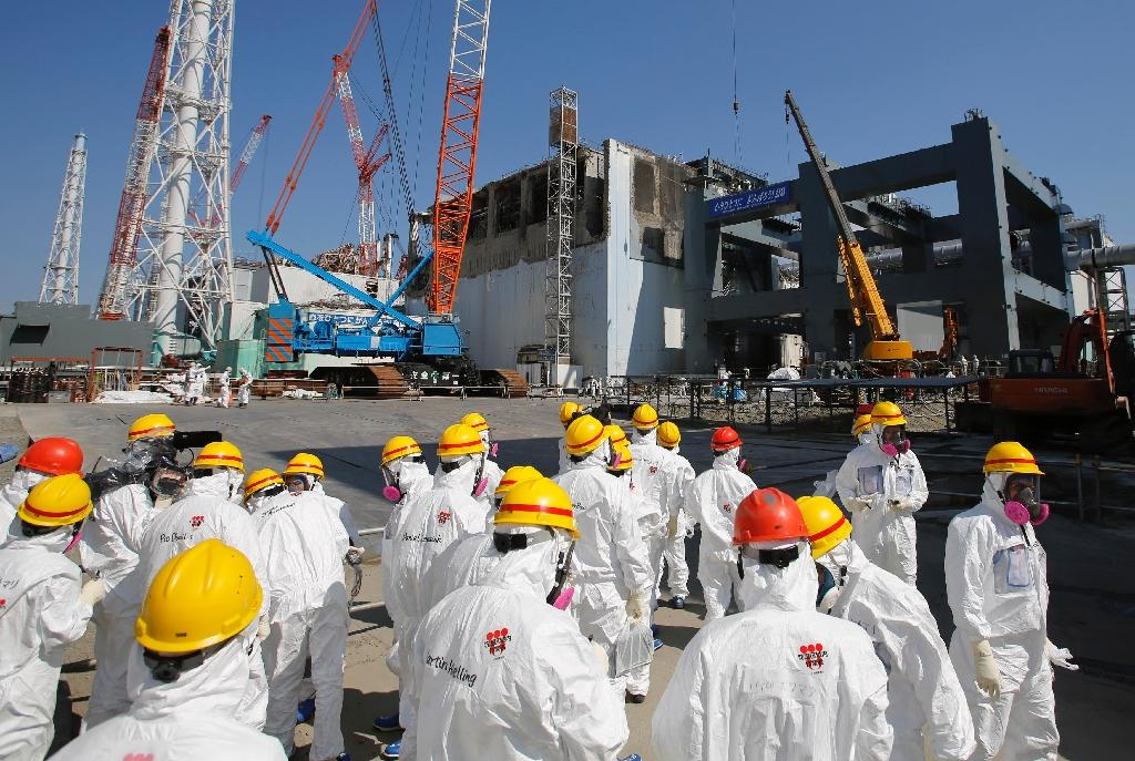 Japan estimates the total cost of the Fukushima disaster could reach 21.5 trillion yen ($189 billion) as high radiation levels slow decontamination operations near the striken reactors (AFP Photo/ISSEI KATO)