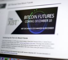 Bitcoin futures rise as virtual currency hits major exchange