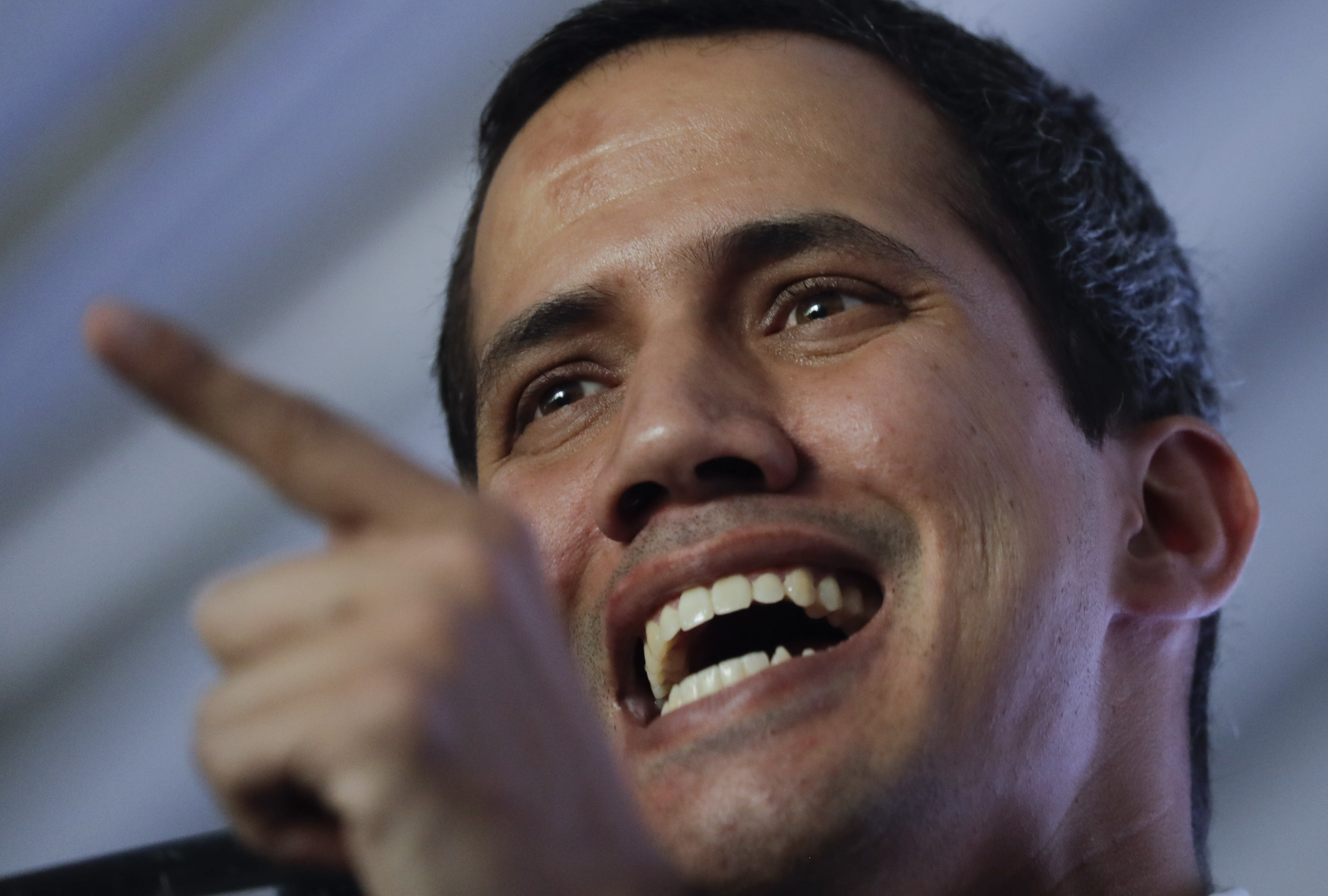 Venezuela's self-proclaimed interim president Juan Guaido talks during a meeting with electricity experts in Caracas, Venezuela, Thursday, March 28, 2019. The Venezuelan government on Thursday said it has barred Guaido from holding public office for 15 years, though the National Assembly leader responded soon afterward that he would continue his campaign to oust President Nicolas Maduro. (AP Photo/Natacha Pisarenko)