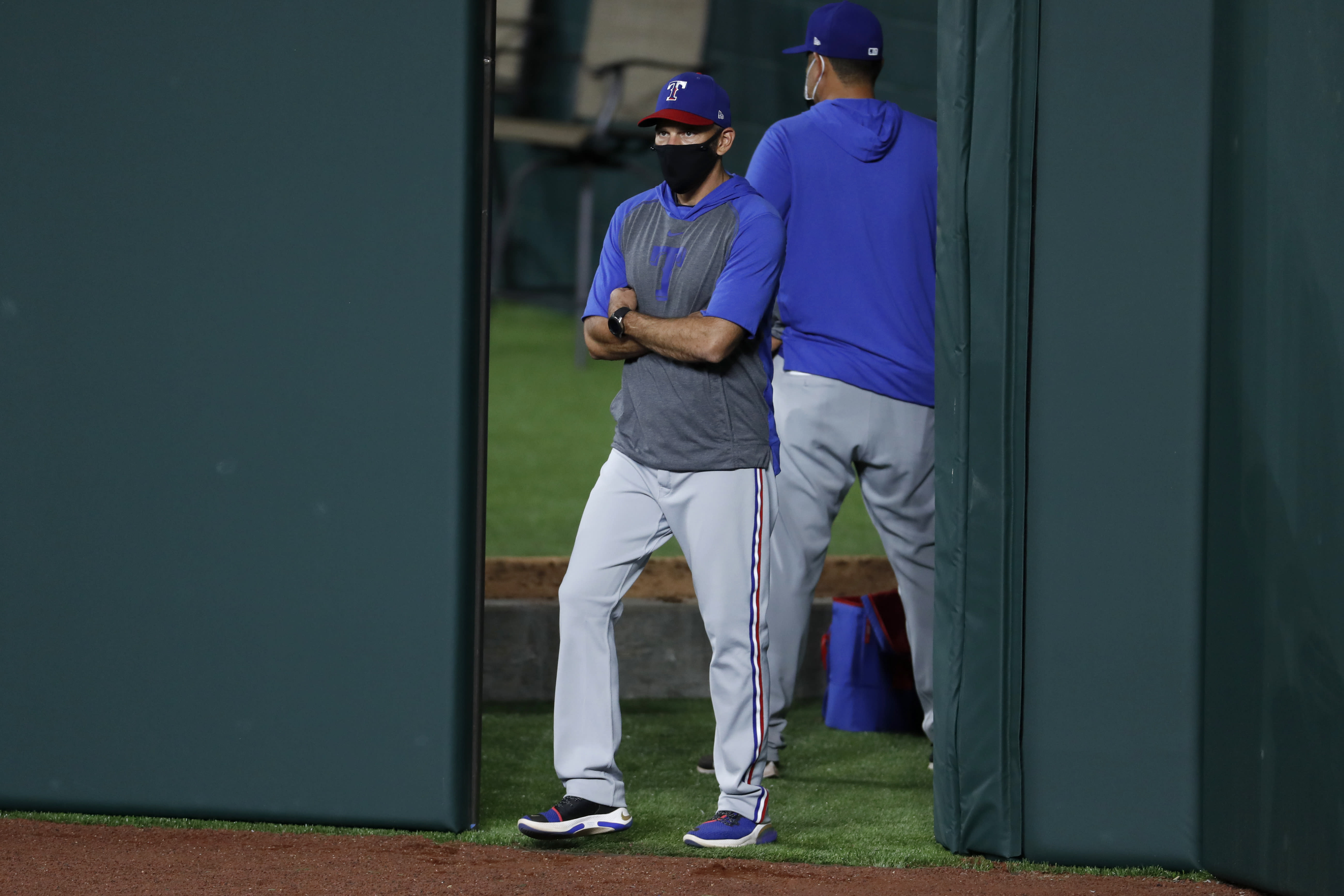 Texas Rangers manager Chris Woodward stands by the bullpen as pitchers prepare for an intrasquad baseball practice at Globe Life Field in Arlington, Texas, Friday, July 3, 2020. (AP Photo/Tony Gutierrez)