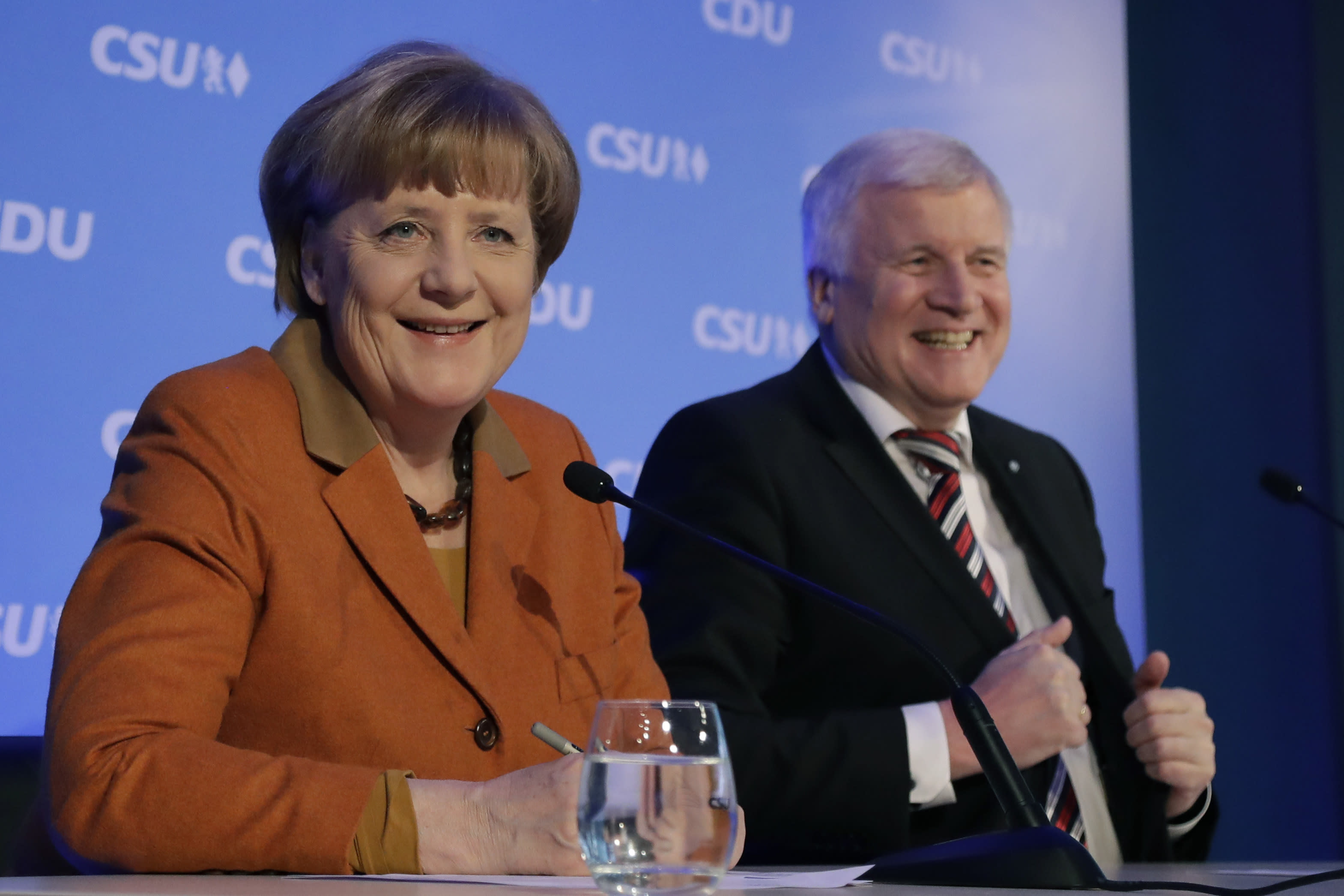 German chancellor and head of the German Christian Democrats, Angela Merkel, left, and Bavarian governor and head of the Christian Social Union party, Horst Seehofer, brief the media during a news conference after a party meeting in Munich, Germany, Monday, Feb. 6, 2017. Merkel was meeting her Bavarian conservative allies in a show of unity following a long-running argument over migrant policy, setting the scene for a joint campaign for German elections in September. (AP Photo/Matthias Schrader)