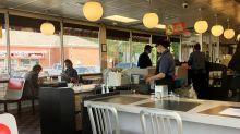 Pence visits Georgia cafe that reopened despite virus