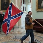 The FBI arrested the man seen with a Confederate flag inside of the US Capitol