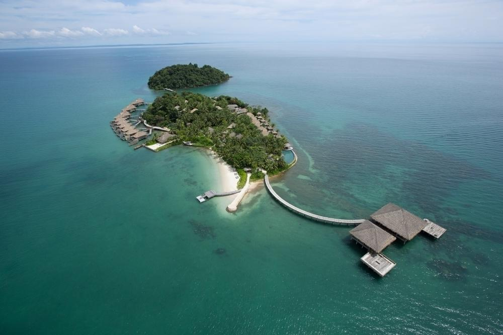 """<p>The first private island resort in the country, set amid the glistening turquoise Gulf of Thailand waters, white sandy beaches and lush virgin rainforests of the Koh Rong Archipelago, <a href=""""http://songsaa.com/"""" target=""""_blank"""">Song Saa</a> provides privileged access to one of Cambodia's most undiscovered locations. Inspired by traditional fishing villages and featuring over-water buildings, thatched roofs and drift wood furnishings, each of Song Saa's 27 sustainably-built villas create the ideal base to enjoy uninterrupted sunrise and sunset views from your private pool or veranda. Prices start from $1,777 per villa per night on an all-inclusive basis.</p>"""