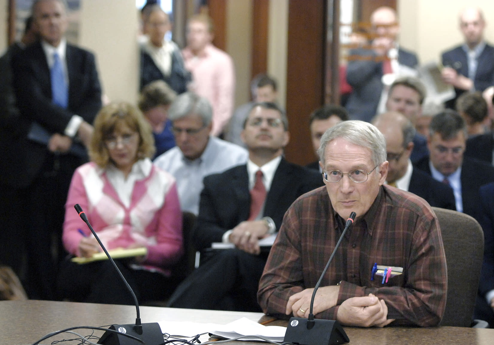 Dr. Lyle Best, of Watford City, N.D., testifies in front of officials with the Oil and Gas Division of the North Dakota Mineral Resources Department at a hearing Tuesday, April 22, 2014, in Bismarck, N.D. The North Dakota Industrial Commission was holding the hearing on its new natural gas flaring policy. (AP Photo/The Bismarck Tribune, Mike McCleary)
