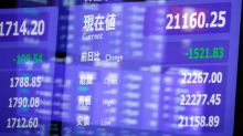 Asia stocks supported by Wall St., but China drags
