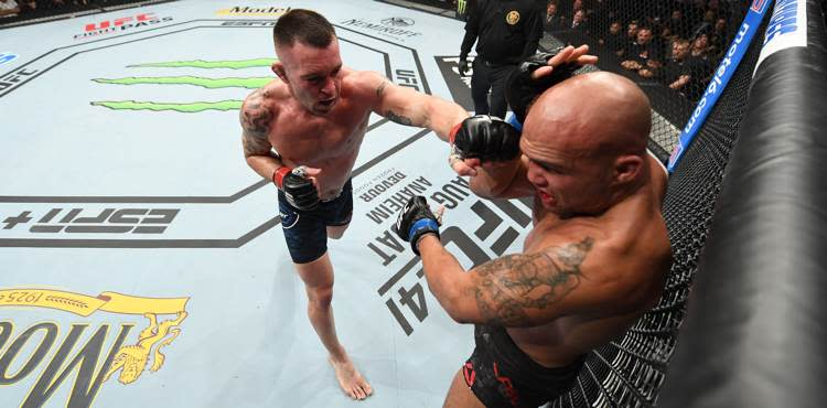 Colby Covington rolls over Rob...