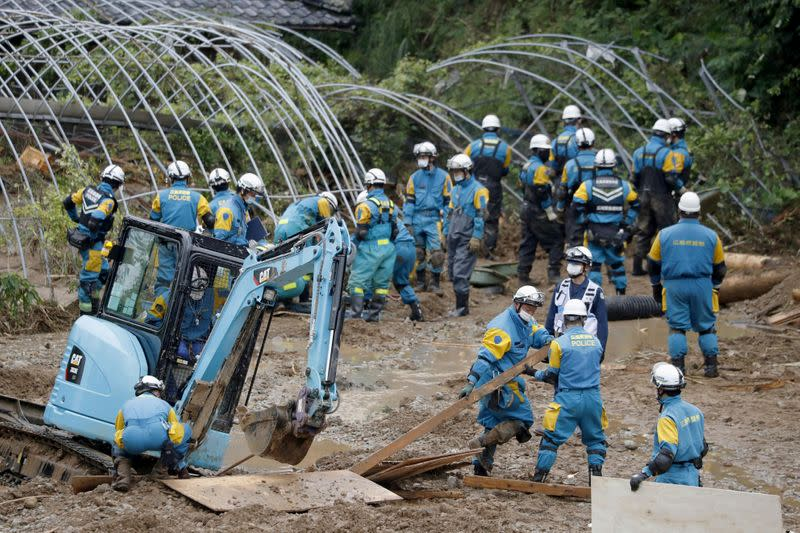 Police officers search missing people at the site of a landslide caused by heavy rain in Tsunagi town, Kumamoto prefecture, southern Japan