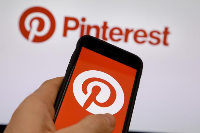 BERLIN, GERMANY - OCTOBER 05: The Logo of Pinterest is displayed on a smartphone on October 05, 2018 in Berlin, Germany. (Photo by Thomas Trutschel/Photothek via Getty Images)