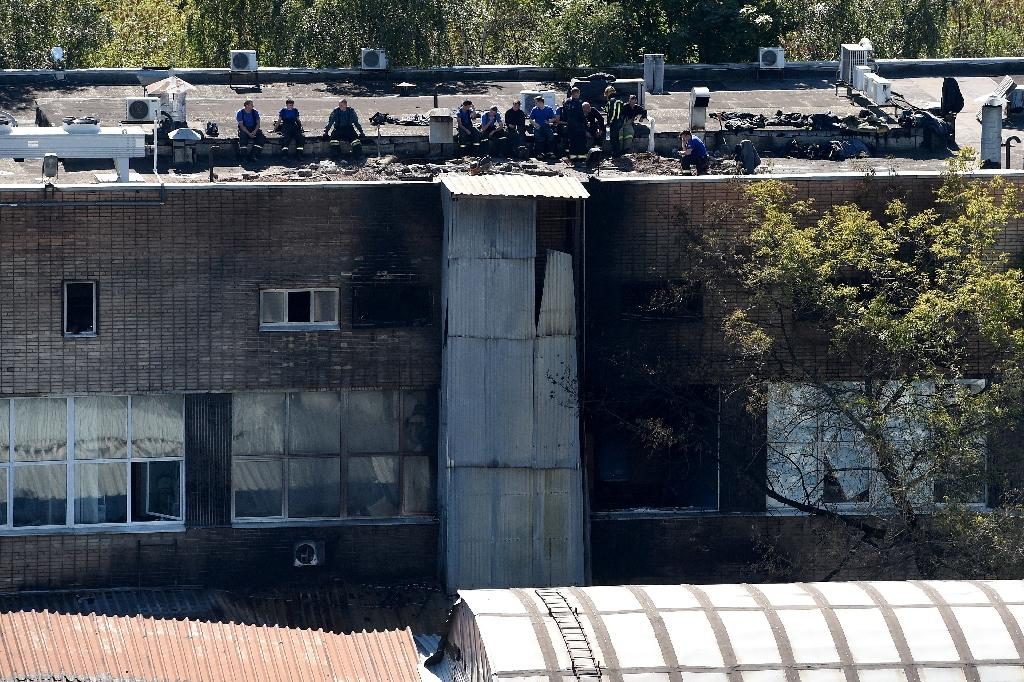 Firefighters work at the site of a fire at a warehouse in Moscow on August 27, 2016
