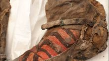 Secrets of Mongolian mummy buried in 'Adidas' shoes 1,100 years ago