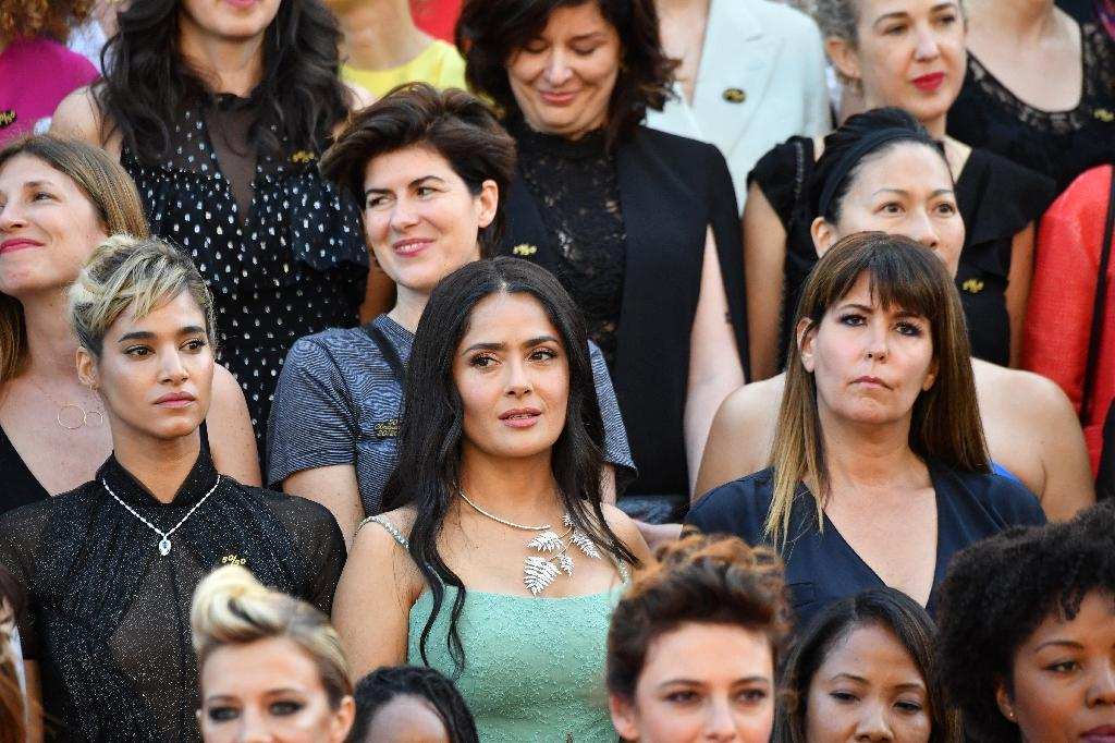 US-Mexican actress Salma Hayek (centre) with other female directors, actresses and industry representatives at a red carpet protest against discrimination in the industry