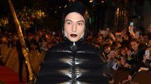 Ezra Miller Stuns in Jaw-Dropping Puffer Coat Dress at 'Fantastic Beasts' Premiere