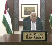 The Latest: Abbas asks for launch of 'genuine peace process'