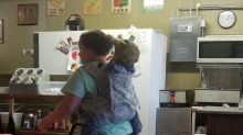 Photo of busy waitress with toddler strapped to her back goes viral