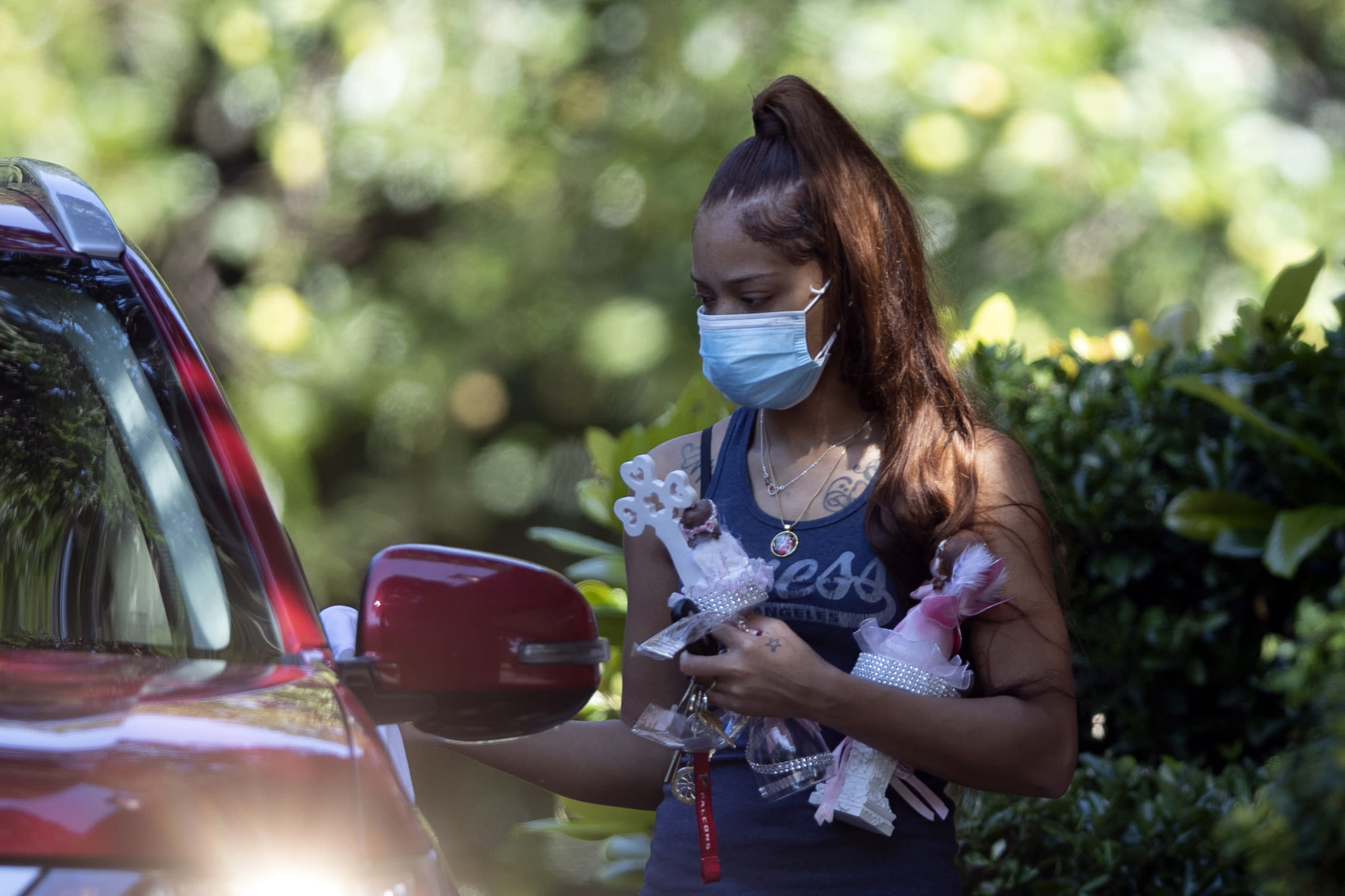 Charmaine Turner prepares to enter a viewing her for 8-year-old daughter Secoriea Turner, who was fatally shot in Atlanta on July 4th near the Wendy's site where Rayshard Brooks was killed the previous month Tuesday, July 14, 2020, in South Fulton, Ga. (AP Photo/John Bazemore)