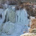 Beautiful ice waterfall remains even after snow