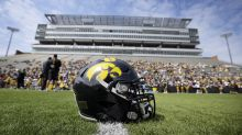 As Iowa cuts sports and staff pay, its football assistant coaches are still set to make more money