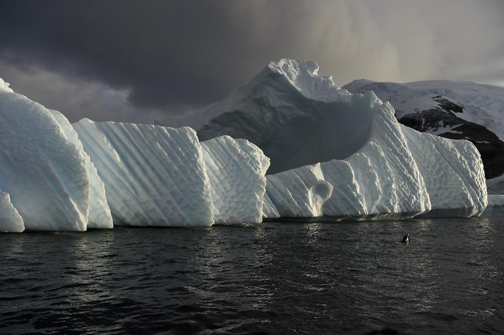 As greenhouse gas emissions continue to rise, so does the sea level (AFP Photo/EITAN ABRAMOVICH)
