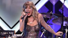 Taylor Swift rings in her 30th birthday party with Jingle Ball concert and cake decorated with cats