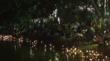 Serene scene during Buddhist ceremony for water goddess in Thailand