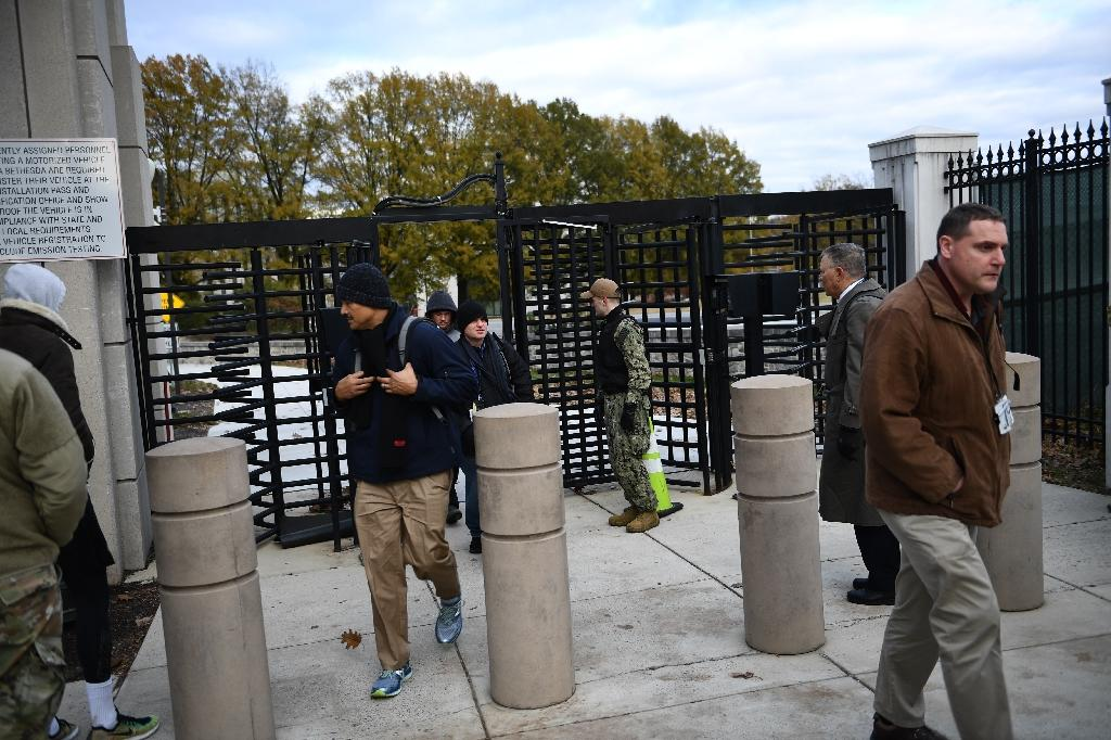 Workers leave Walter Reed National Military Medical Center on November 27, 2018, amid reports of an active shooter that turned out to be a drill