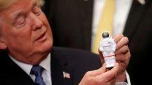 Trump wants to send U.S. astronauts back to moon, someday Mars