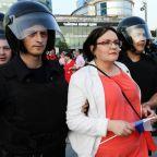 Russian investigators search homes of Kremlin critics