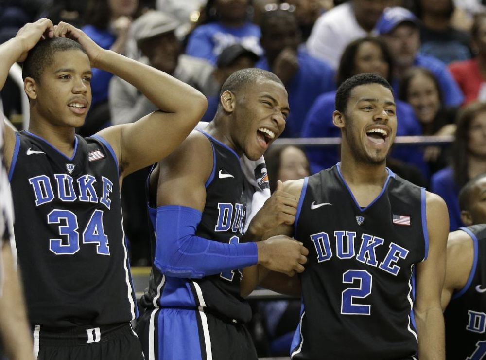 Duke players, from left, Andre Dawkins, Rasheed Sulaimon, and Quinn Cook react to a teammate missing a shot late in the second half of an NCAA college basketball game against Elon in Greensboro, N.C., Tuesday, Dec. 31, 2013. Duke won 86-48