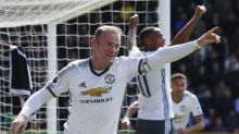 Rooney scores on return as United close in on City