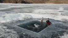 Russian man swims 25m under ice at world's deepest lake