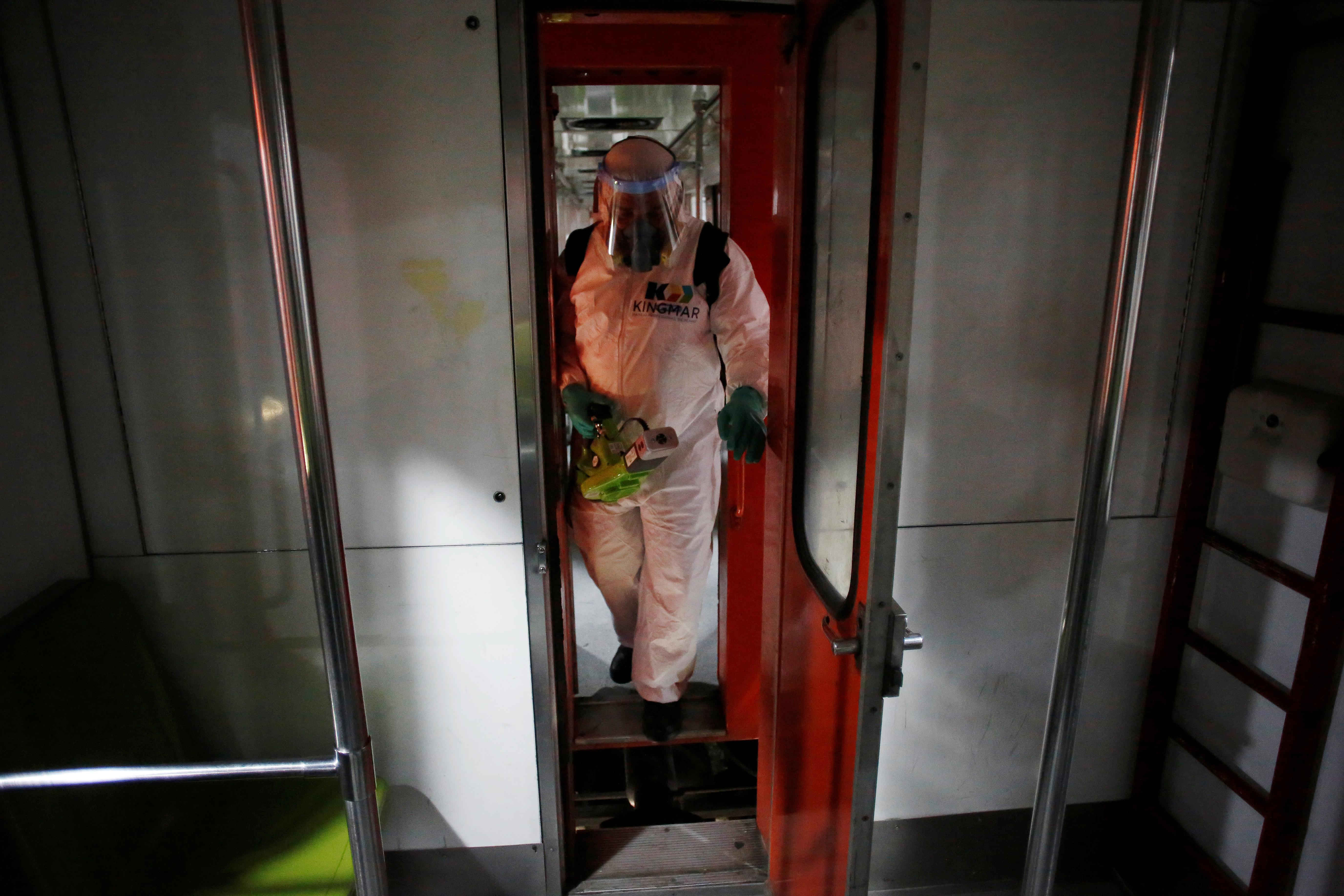 A worker carries out the disinfection of a metro car, as part of Mexico City's government's measures in response to the coronavirus disease (COVID-19), in Mexico City