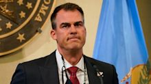 Oklahoma governor orders day of prayer for Covid but no mask mandate
