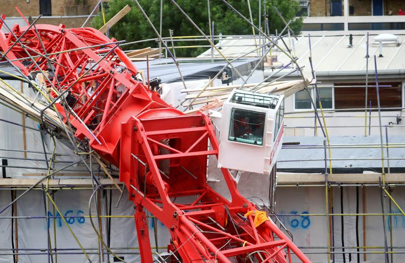 A collapsed crane is seen at a construction site in Bow, east London