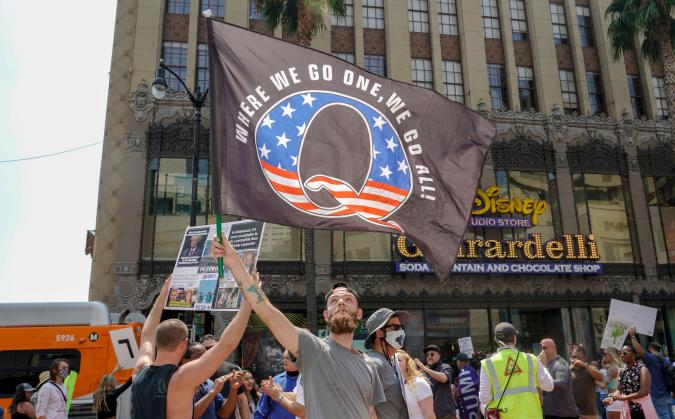 Conspiracy theorist QAnon demonstrators protest child trafficking on Hollywood Boulevard in Los Angeles, California, August 22, 2020. - A 2019 bulletin from the FBI warned that conspiracy theory-driven extremists are a domestic terrorism threat. (Photo by Kyle Grillot / AFP) (Photo by KYLE GRILLOT/AFP via Getty Images)