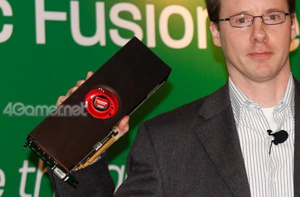 AMD Radeon HD 6990 shows up in its metallic flesh, looking larger than life