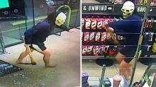Masked man caught on video smashing servo doors in terrifying rampage