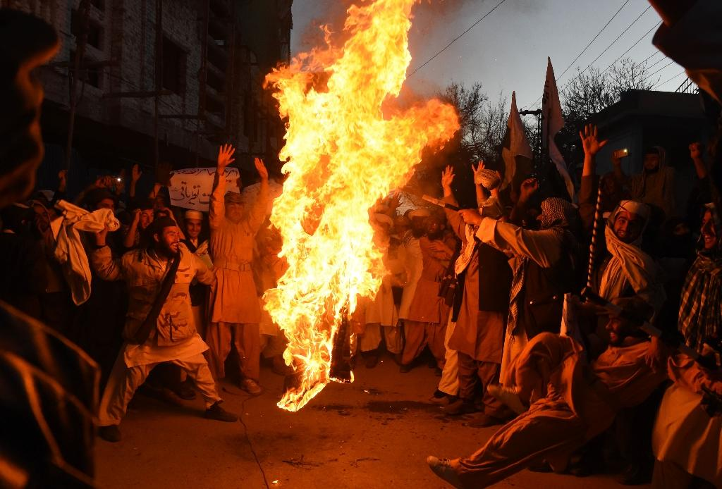 Pakistani demonstrators burn the US flag at a protest in Quetta on Jan 4 as Washington escalated its criticism over militant safe havens