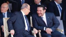 Hariri, back in Beirut, attends national day parade