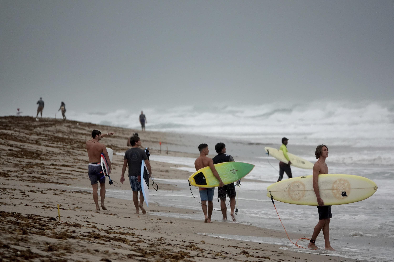 Surfers in Delray Beach enjoy the waves, Sunday, Aug. 2, 2020, as Tropical Storm Isaias brushes past the East Coast of Florida. (Joe Cavaretta/South Florida Sun-Sentinel via AP)