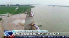 China relieves pressure on overflowing lake as floods continue