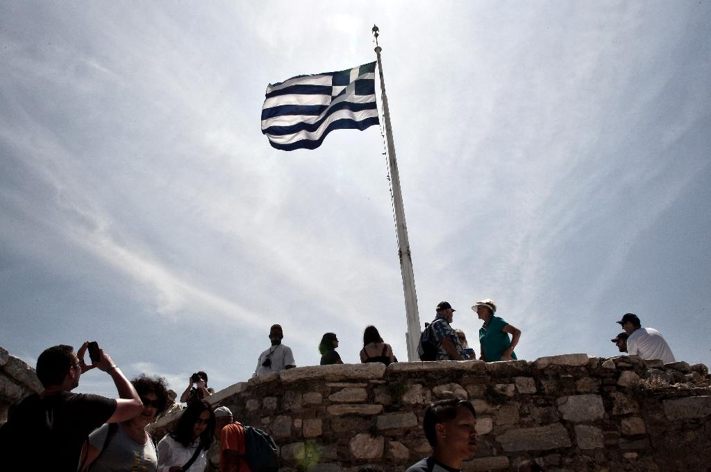 Debt relief for Greece -- a key demand of the IMF but opposed by Germany -- will be discussed by officials who will report back to eurozone finance ministers on May 24 (AFP Photo/Louisa Gouliamaki)