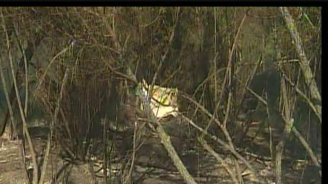 Homeless camp found near riverbed and fire site