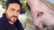 Padre Fábio de Melo tatua abelha na mão em homenagem à mãe