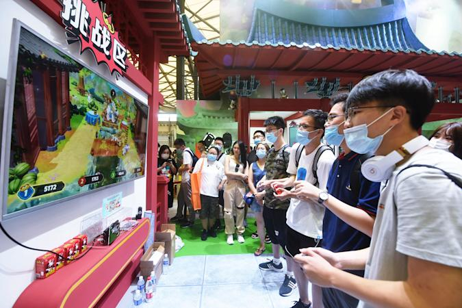 SHANGHAI, CHINA - JULY 31: Visitors play a video game during the 2020 China Digital Entertainment Expo & Conference (ChinaJoy) at Shanghai New International Expo Center on July 31, 2020 in Shanghai, China. (Photo by Long Wei/VCG via Getty Images)