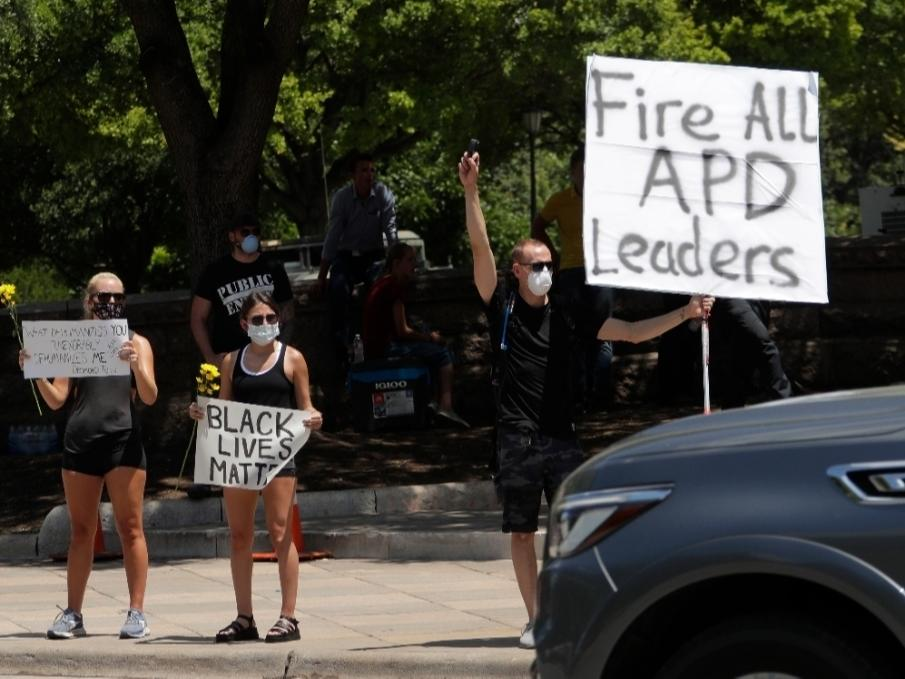 ​Demonstrators gather near the state Capitol in Austin on June 6 to protest the death of George Floyd, a black man who was in police custody in Minneapolis. In August, Austin's city council voted to cut its police department's budget by $150 million.