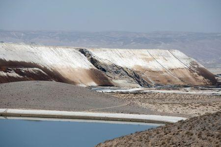 A collapsed wall of a reservoir holding a highly acidic wastewater is seen in Mishor Rotem, in Southern Israel July 4, 2017. REUTERS/Baz Ratner