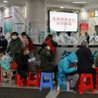 China deploys army medics to overwhelmed virus epicentre