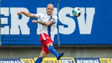 Soccer player Toni Leistner leaps into stands to attack fan after German Cup defeat