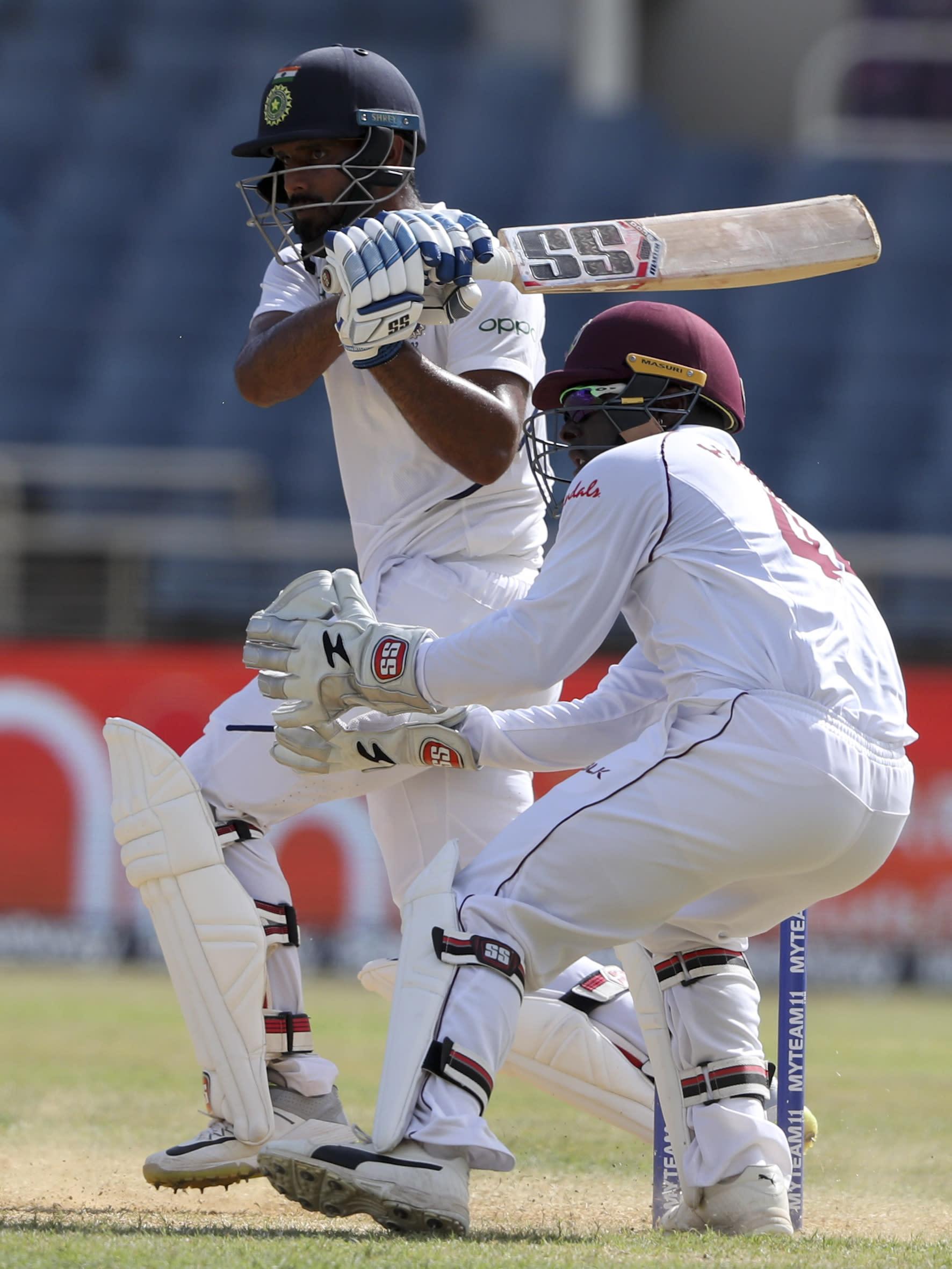 India's Hanuma Vihari plays a shot against West Indies during day three of the second Test cricket match at Sabina Park cricket ground in Kingston, Jamaica Sunday, Sept. 1, 2019. (AP Photo/Ricardo Mazalan)